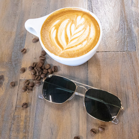 Wired framed sunglasses with a coffee shop latte