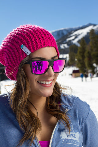 Women skiing in polarized and uv protected sunglasses