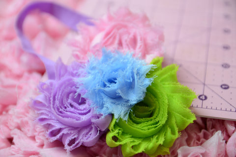 Shabby Rose flower headband with pink, lilac, blue,and green on a purple headband - Pretty's Bowtique