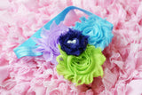 Shabby Rose flower headband with purple, lilac, blue,and green on turquoise headband with pearls - Pretty's Bowtique