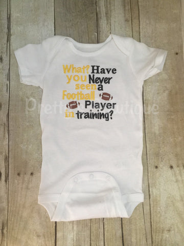 What have you never seen a football player in training Football shirt for babies, toddler, and children.  You pick team colors