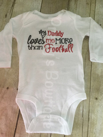 My Daddy loves me more than football bodysuit or shirt.  Can customize colors - Pretty's Bowtique