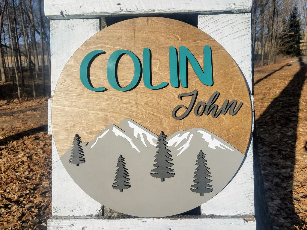 Round Personalized Nursery Name Sign with Raised Lettering and Mountain Scene