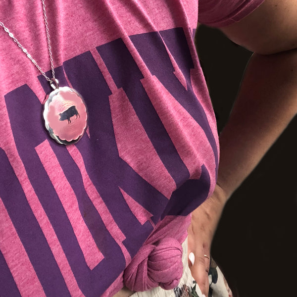 pink lucky pig pendant on silver chain