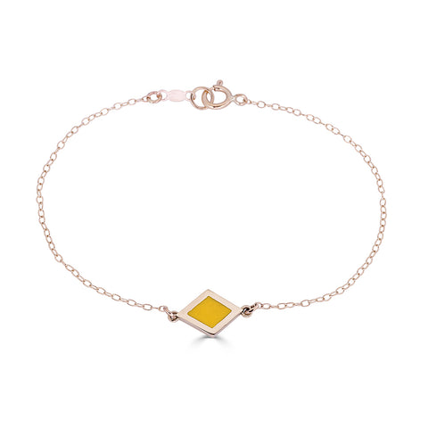 yellow, red and green enameled geometric charm stations on delicate 14k gold chain bracelet