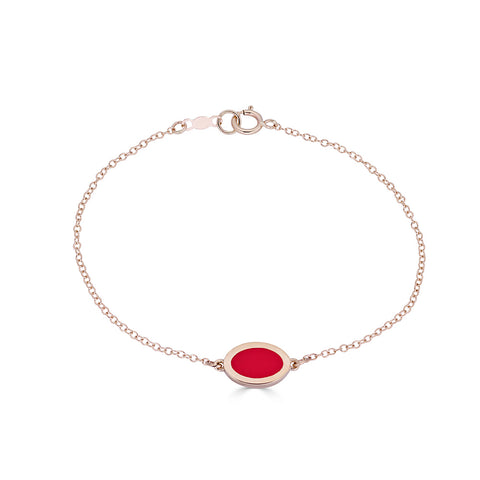 oval charm with red enamel on delicate 14k gold chain and gold and blue signet ring