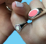 shield shaped enameled pinky ring with garnets, black silver and pearl enamel and pink enamel signet ring