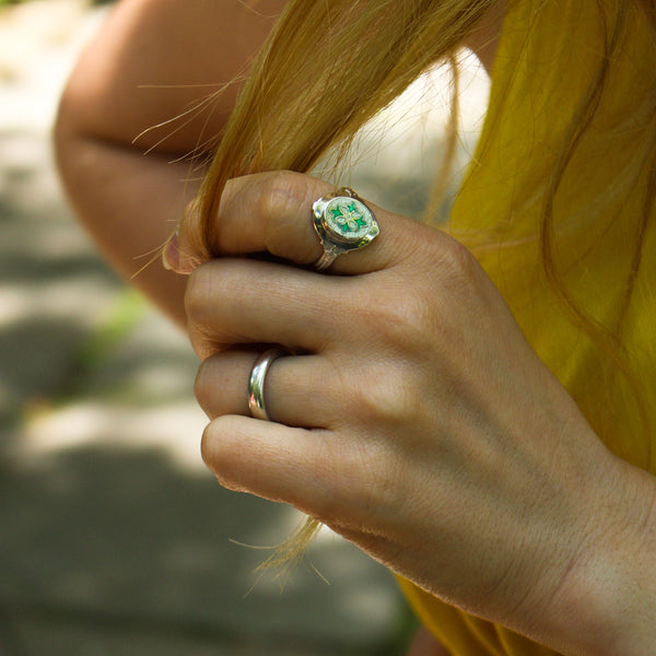 green enameled quatrefoil stained-glass inspired ring