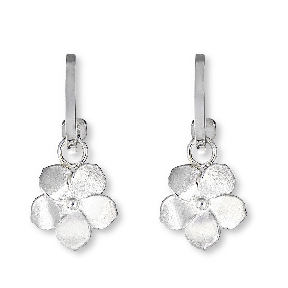 silver flower charms on hoop earrings