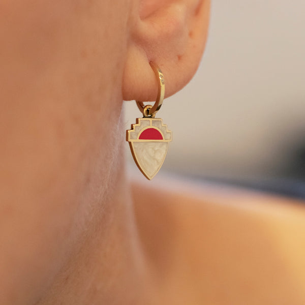 hoop earrings with red and white enamel shield charm drop