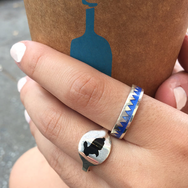 black silhouette bunny ring and blue zig zag ring