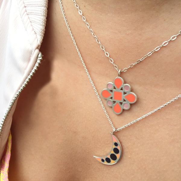orange and red enamel moon and flower layered necklaces