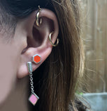 earring stack with pink and silver diamond drop earring and red enameled hexagon posts