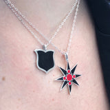 black and red layered star and enamel shield necklaces