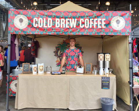 andrew standing behind good trip coffee booth at big wonderful