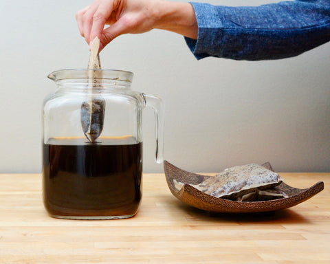 Cold Brew Coffee removing brew bags from pitcher on table
