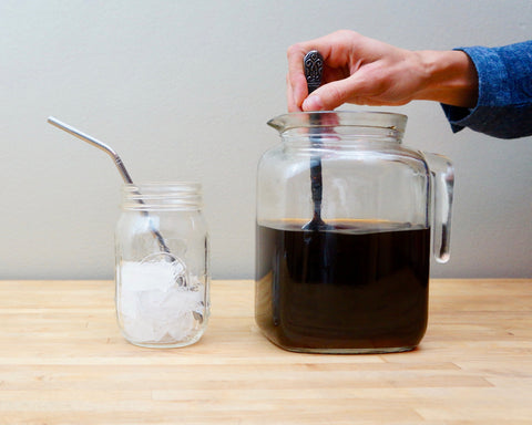 Cold Brew Coffee stir cold brew in pitcher on table