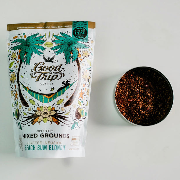 bag of good trip coffee beach bum blondie mixed grounds sitting on white table with ingredients