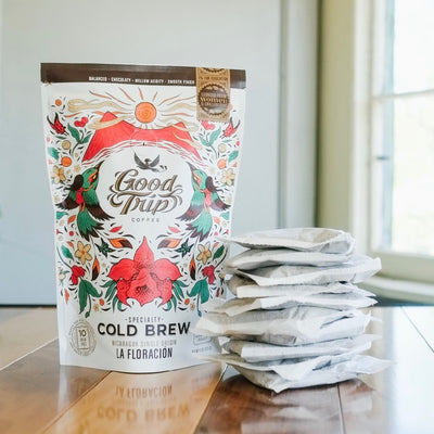 bag of good trip coffee la floracion nicaragua single origin cold brew sitting on table next to stack of compostable ready-to-steep brew bags