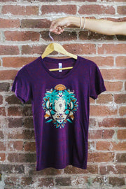 good trip coffee trippy mandala women's tee on hanger against brick wall
