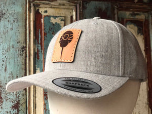 302 Leather patch/wool blend hat