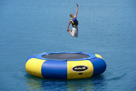 Aqua Jump 150 Northwoods Water Trampoline by Rave Sports  in the lake