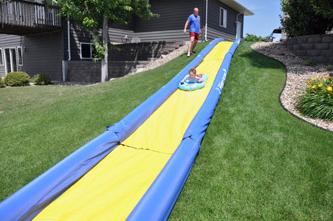 The Turbo Chute Water Slide Backyard Package by Rave Sports installed in a backyard