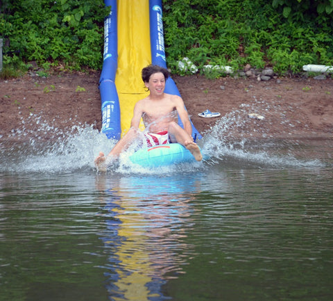 Rave Sport water slide lake package in use