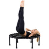 Image of Nimbus Fitness trampoline by SkyBound with woman doing exercises