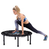 Image of SkyBound Nimbus Folding Fitness Bungee Cord Rebounder Trampoline woman stretching on it