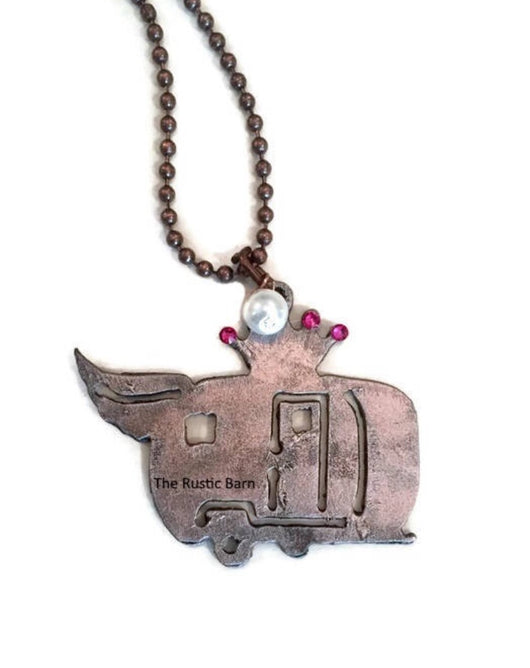 Rustic Metal Pink camper trailer with wing and crown