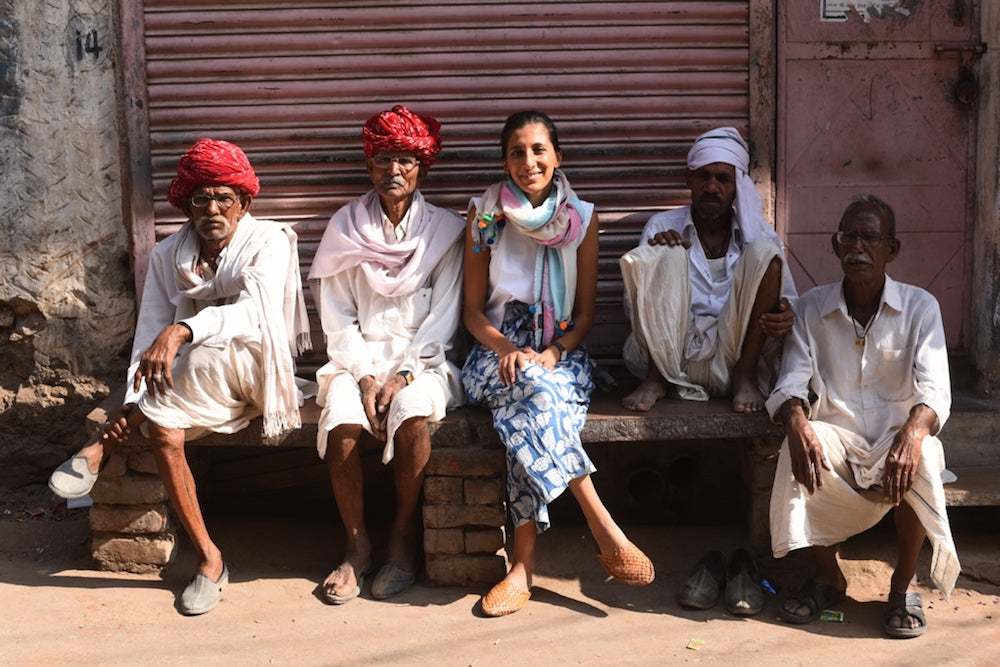 Sustainable fashion brand owner Rakhee Shah with local craftsmen in Jaipur