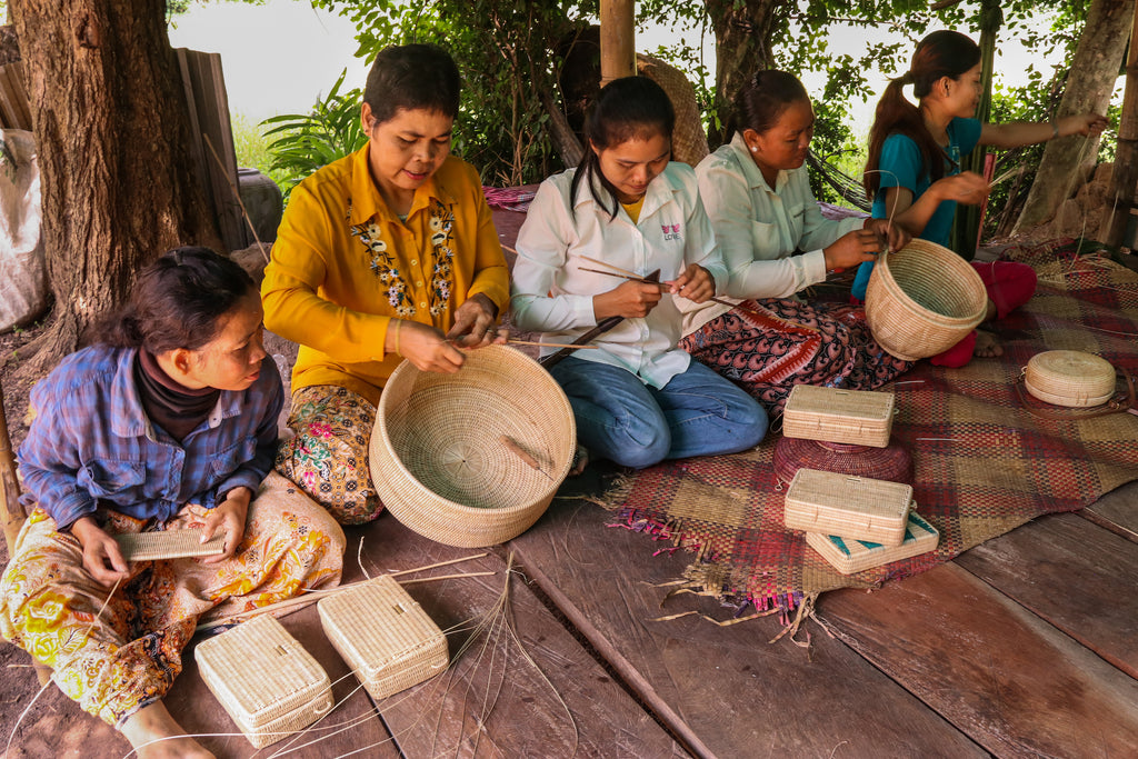 Female Cambodian artisans in Krobey Riel village hand weaving rattan bags by MANAVA, available on ZERRIN