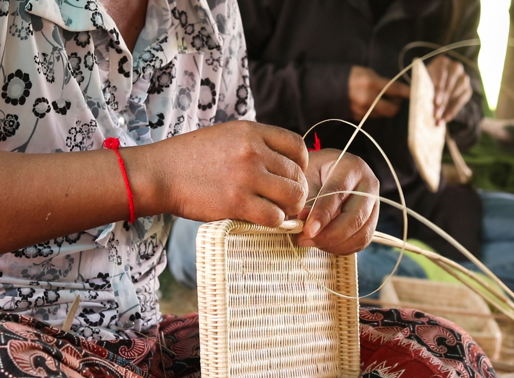 The rattan Syuti bag by MANAVA being handwoven by artisans in Krobey Riel Village, Cambodia.