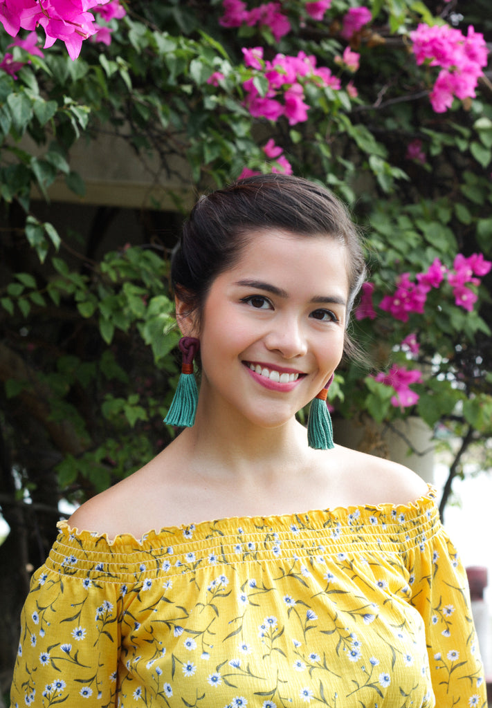 Nutritionist and radio host Charlotte Mei wears handcrafted tassel earrings by Talee, available on ZERRIN