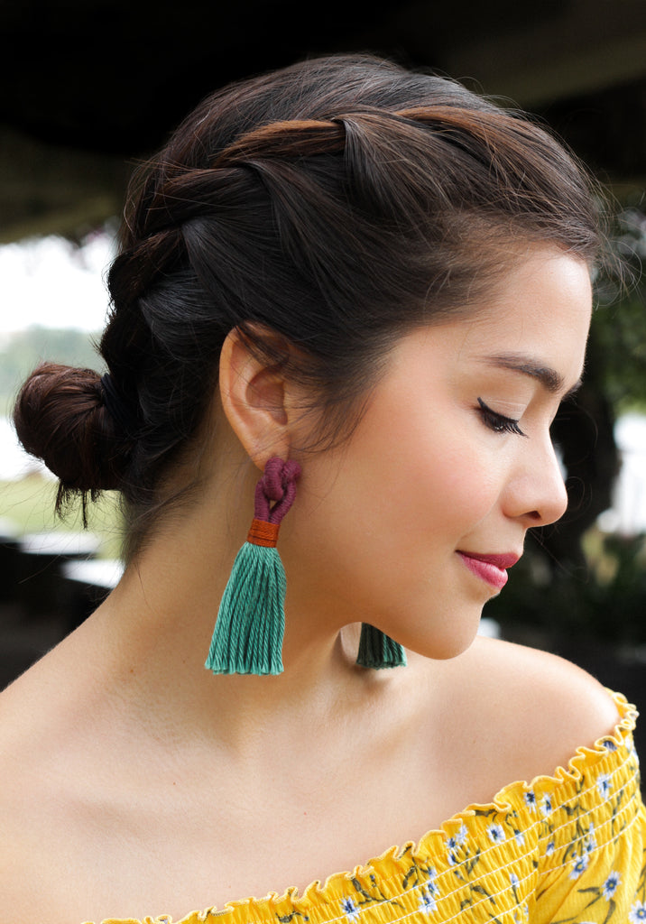 Charlotte Mei wears Talee Hati tassel earrings in plum and rainforest, available on ZERRIN