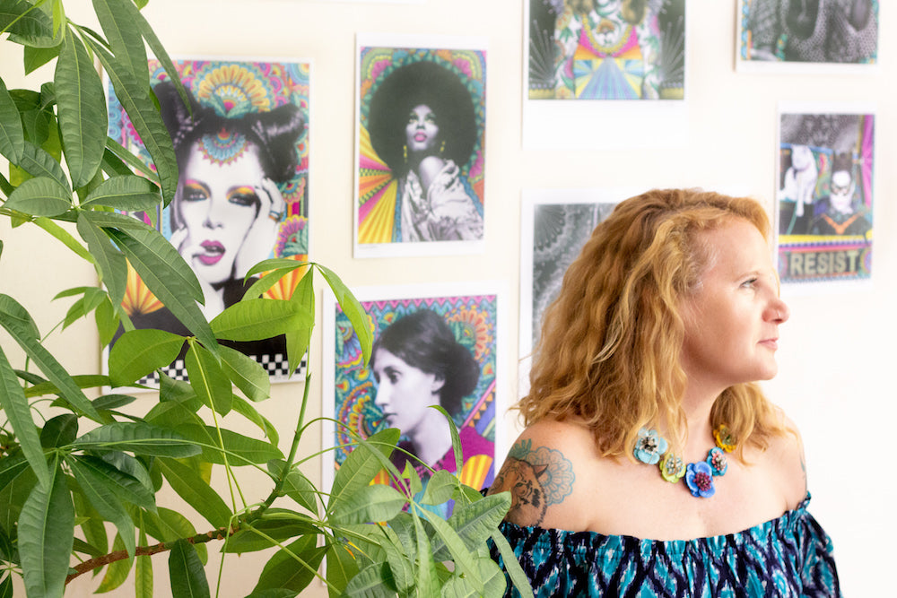 Vicky Harris, artist and passionate feminist, in her studio surrounded by artwork wearing sustainable fashion from ZERRIN