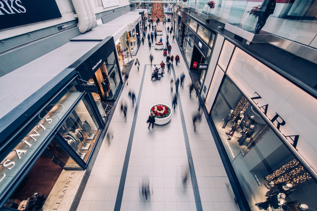 A busy shopping mall with fast-fashion brands