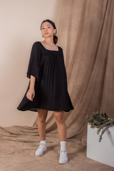 Whispers & Anarchy Exposed Back Bell Sleeve Dress in Jet Black