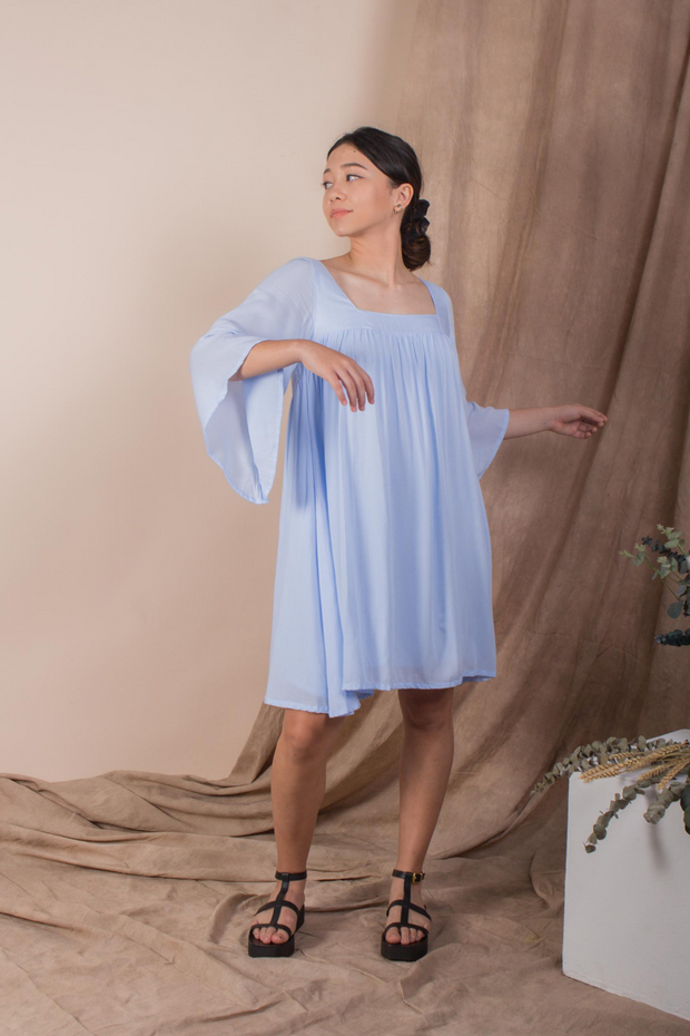 Whispers & Anarchy Exposed Back Bell Sleeve Dress in Blue Ice Melt