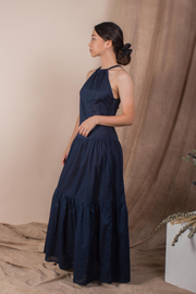 Side view of Whispers & Anarchy Halter Maxi Dress in Navy, available on ZERRIN
