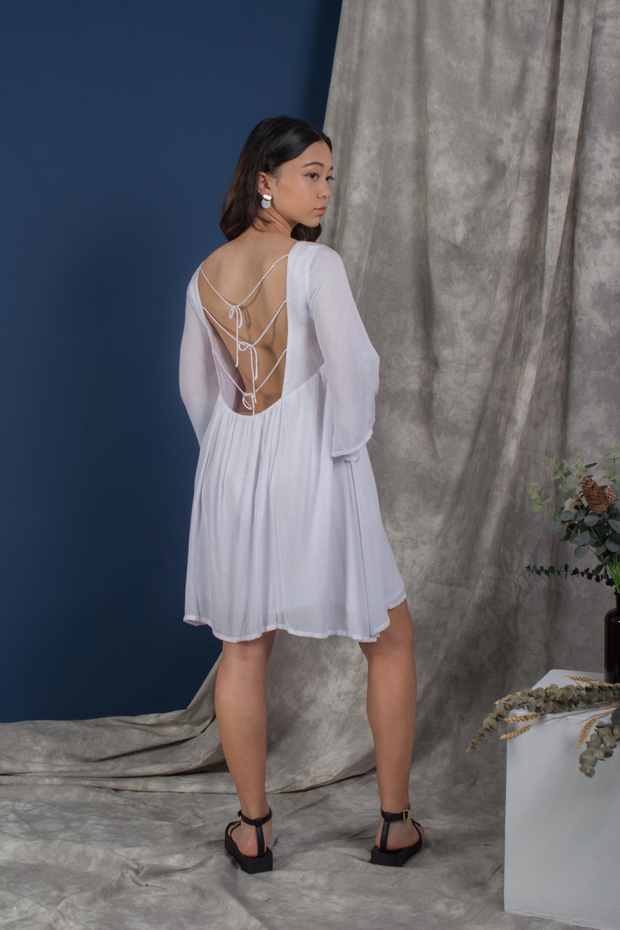 Back view of Whispers & Anarchy Exposed Back Bell Sleeve Dress in White, available on ZERRIN