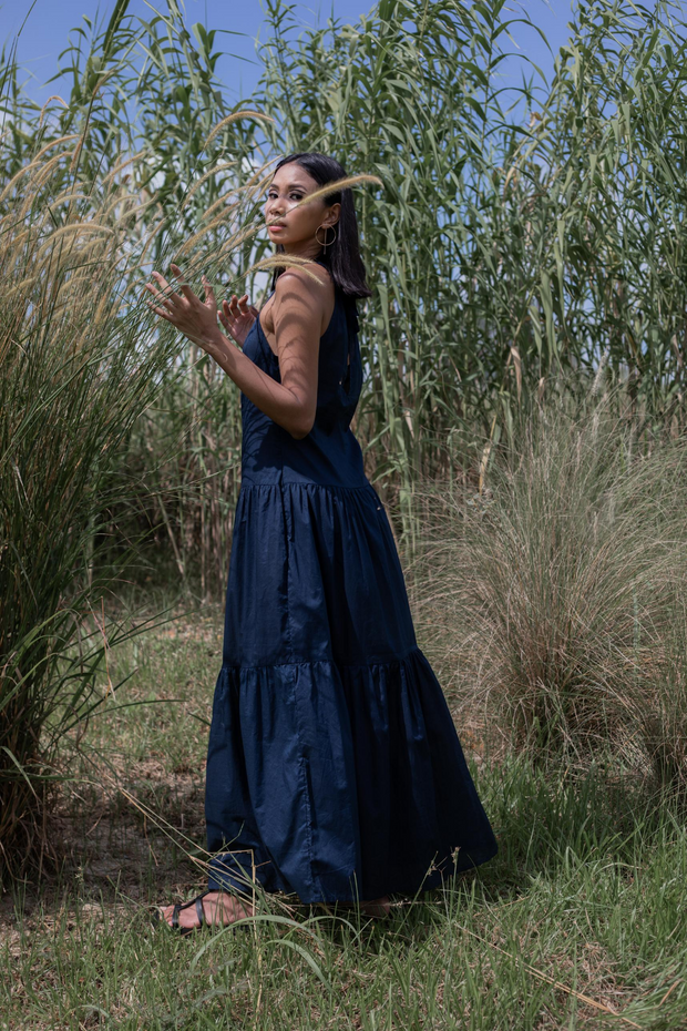 Model wears Whispers & Anarchy Halter Maxi Dress in Navy, available on ZERRIN
