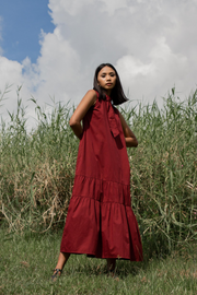 Model wears Whispers & Anarchy Trapeze Midi Dress in Blood Red