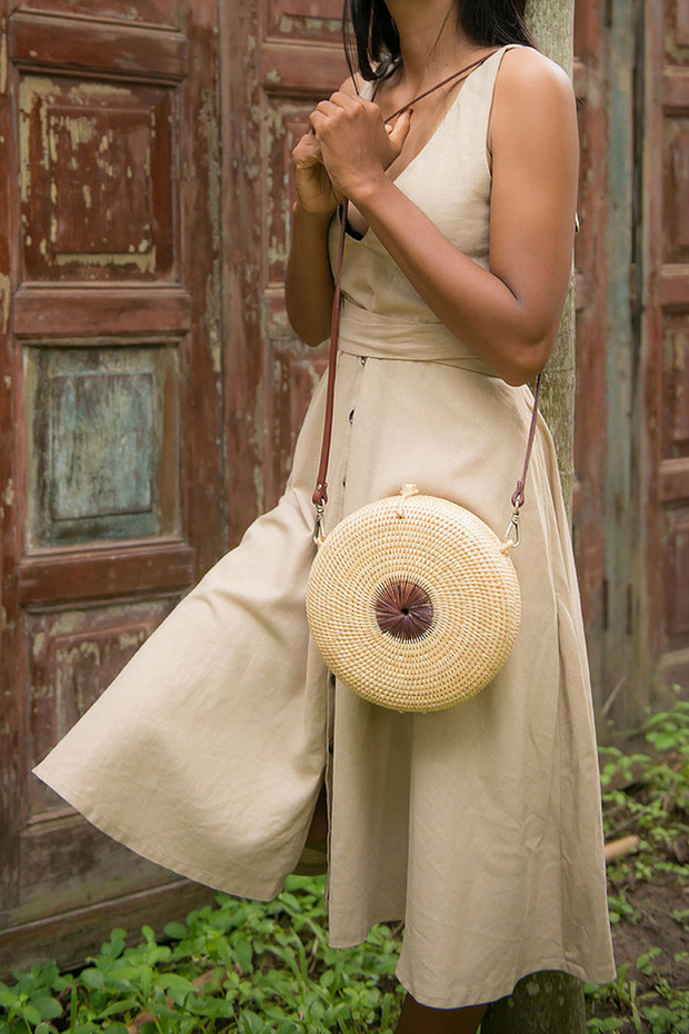 Model wears Manava handcrafted Mandala rattan roundie bag, available on ZERRIN