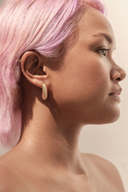 Side view of Pyar Saturn Gold Stud Hoop Earring, available on ZERRIN with free local Singapore shipping
