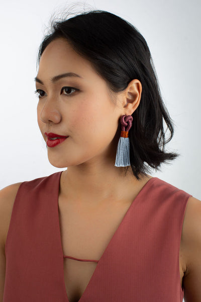 Model wears Talee Hati tassel earrings in Plum & Blue Harbour, available on sustainable fashion store ZERRIN