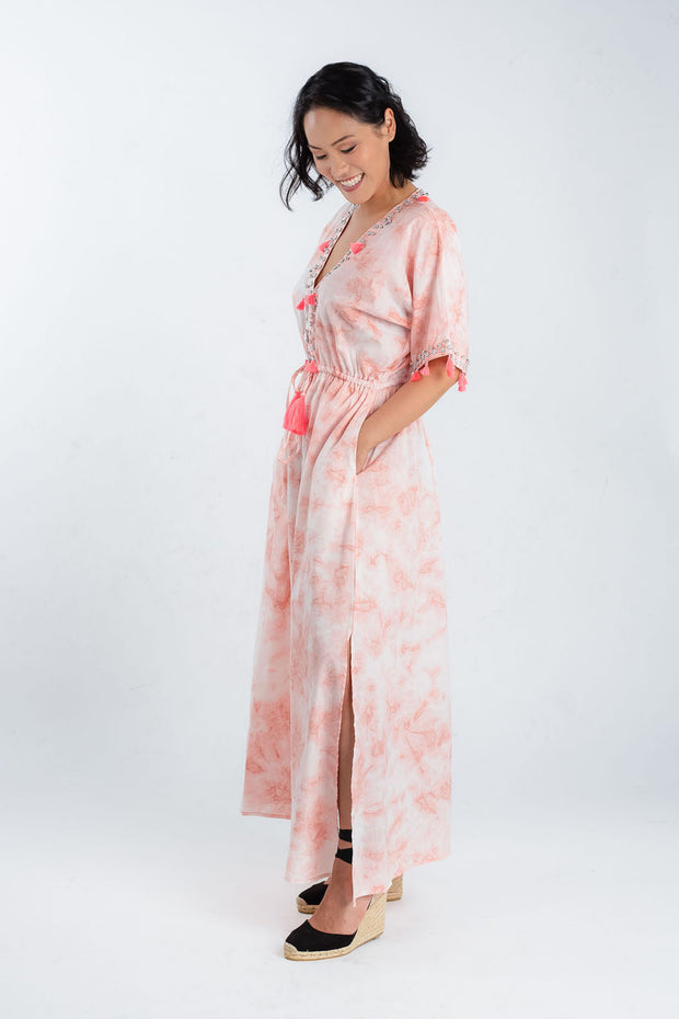 Model wears organic cotton maxi dress with leg split by Baliza, available from sustainable fashion store ZERRIN