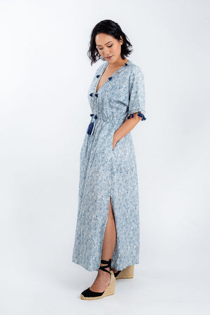 Model wears organic cotton split leg maxi shell dress by Baliza, available on sustainable fashion store ZERRIN