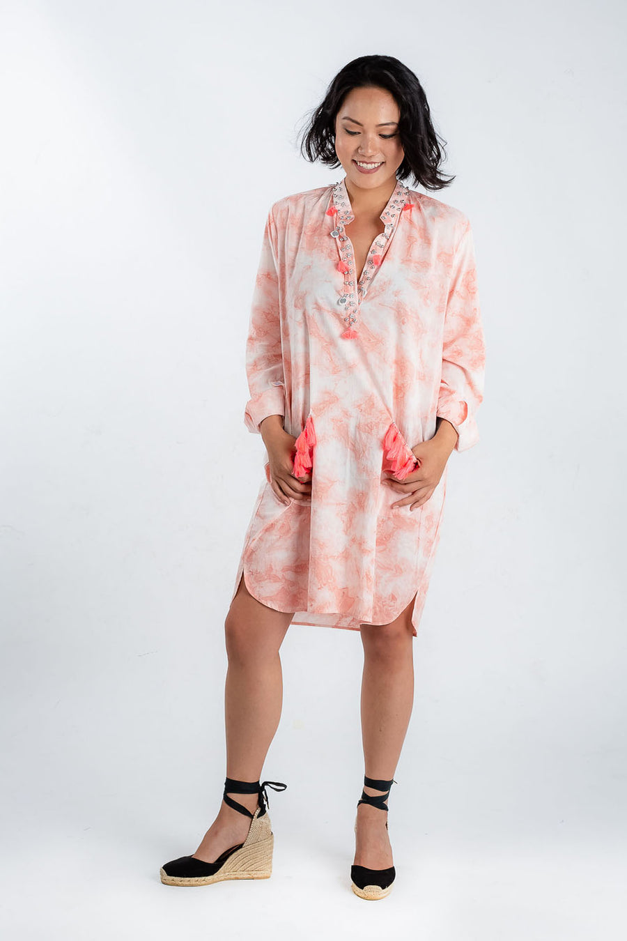 Model wears Baliza organic cotton shell shirt dress in pink tie dye, available on sustainable fashion store ZERRIN